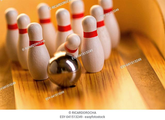 Bowling ball striking pins Stock Photos and Images | age
