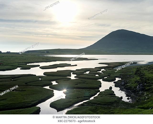 Isle of Harris, part of the island Lewis and Harris in the Outer Hebrides of Scotland. The coastal salt marsh near Northton during sunset
