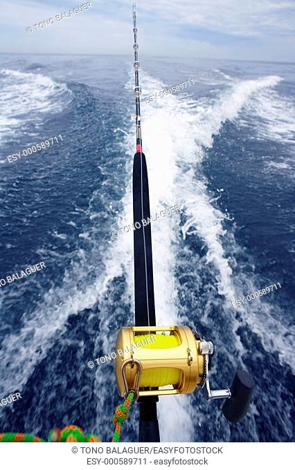 fishing big game rod and reel on boat wake prop wash