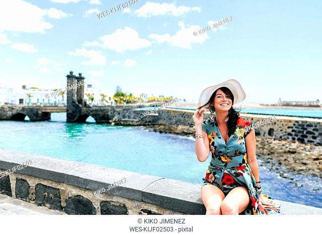 Woman with white sun hat in Arrecife, Spain