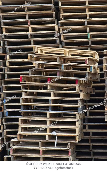 Stacks of pallets at pallet recyling business in Michigan, USA