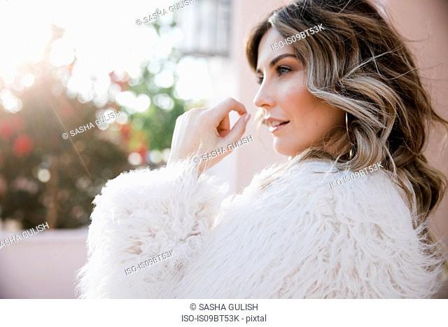 Fashionable woman in fake fur coat