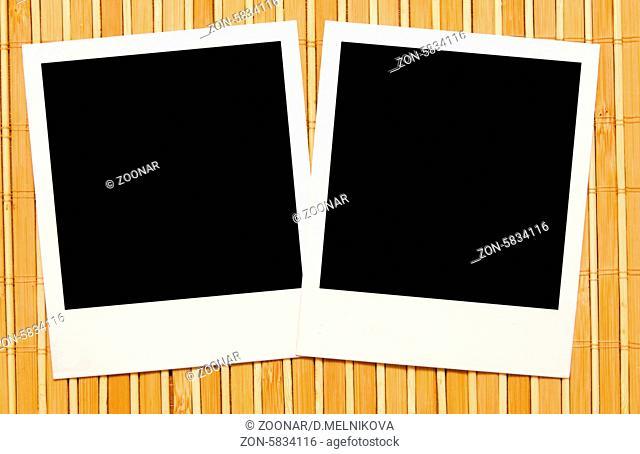 photo frames against wooden backgound
