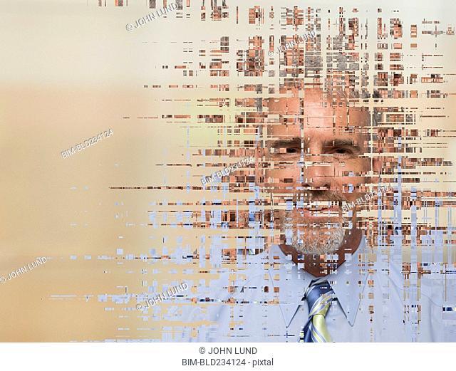 Pixelated face of Caucasian businessman