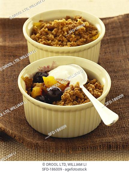 Mango and blueberry crumble with yoghurt