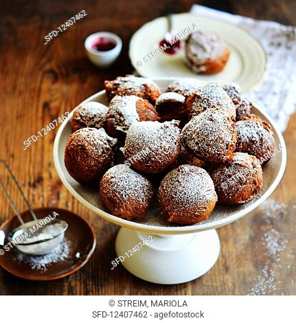 Doughnuts with icing sugar on an étagère