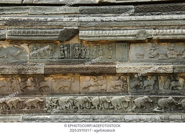 Carving details on the outer wall of Mahanavami Dibba. Pyramidal three tiered 8 meter high stone platform made from granite. Hampi. Karnataka, India