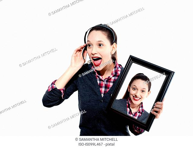Young woman on headset with picture of herself
