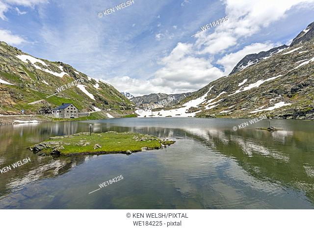 Col du Grand St-Bernard. View across Great St. Bernard Lake to the Great St. Bernard Hospice. The lake is on the border between Valais Canton