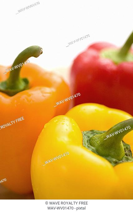 Close-up of yellow, orange and red peppers