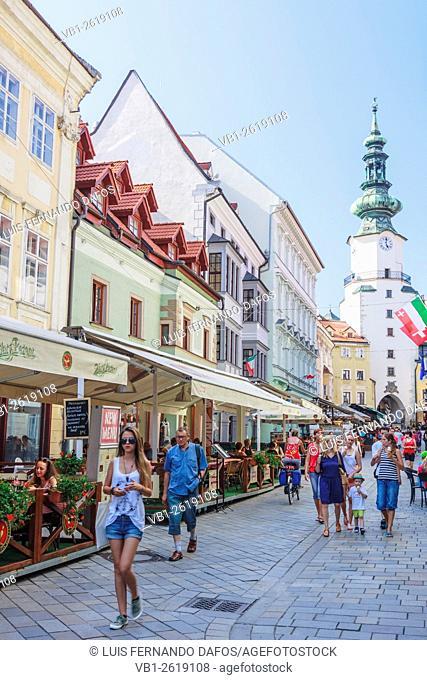 Michael's Gate and people at Venturska Michalska the Old Town's main street in Bratislava, Slovakia