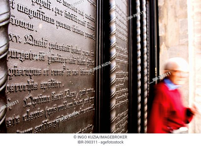 Symbolically fixed 95 theses of the reformer Martin Luther at the gate of the castle church, City of Luther Wittenberg, Saxonia-Anhalt, Germany