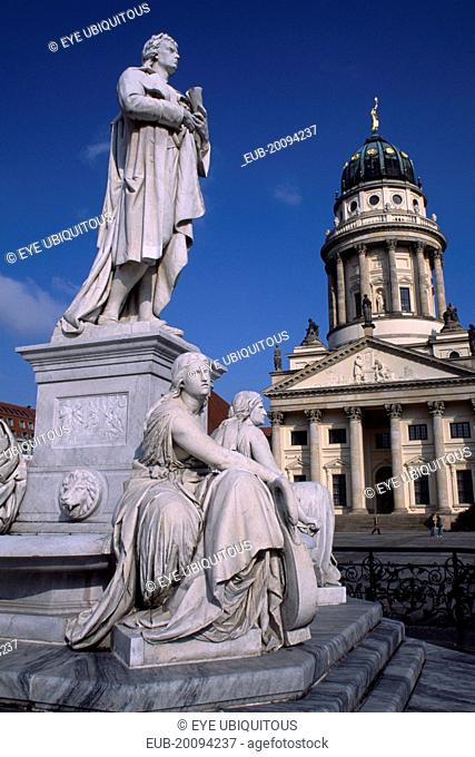 The Friedrich Schiller Memorial statue by Reinhold Begas in front of the Konzerthaus home of the Berlin Symphony Orchestra with Franzosischer Dom on right