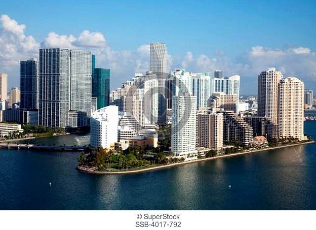 Aerial of Brickell Key Skyline in Miami from over Biscayne Bay