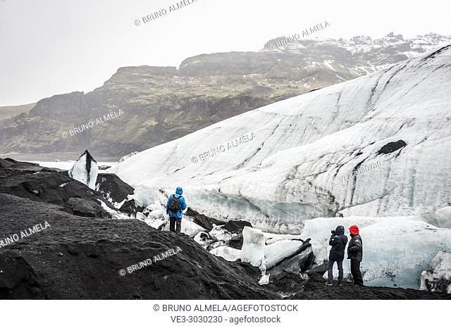 Tourists visiting Sólheimajökull glacier (region of Suðurland, Iceland)
