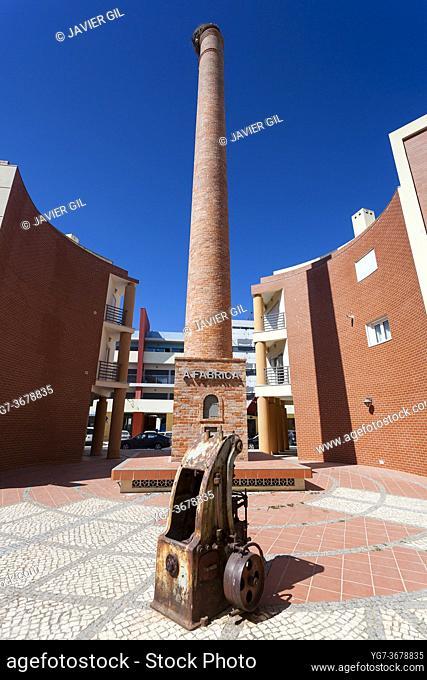 Chimney of industry in Portimao, Algarve, Portugal