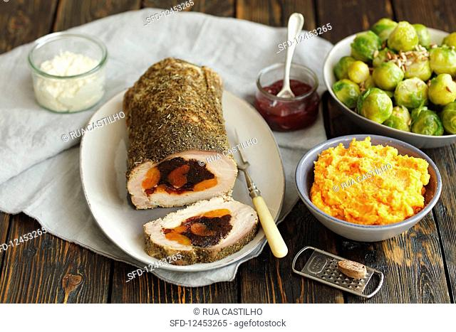 Baked pork loin stuffed with prunes and dried apritots, brussel sprouts, sweet potatoes pure