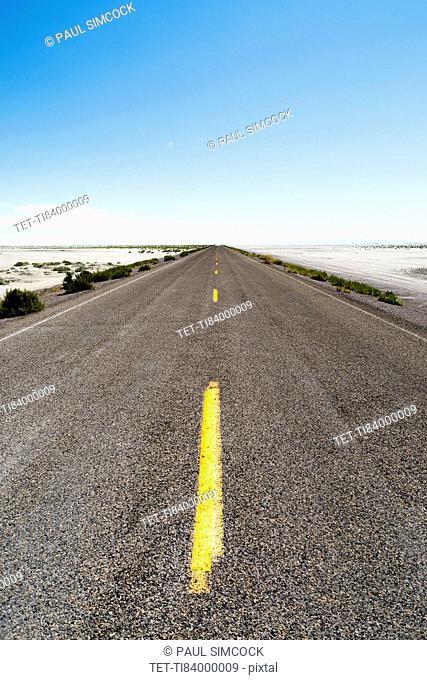 USA, Utah, Wendover, Bonneville Salt Flats, Blue sky over empty road