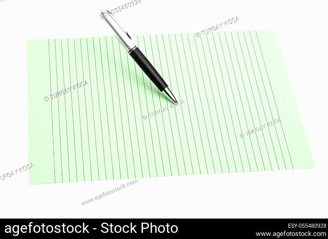 Pen and color paper on an isolated background