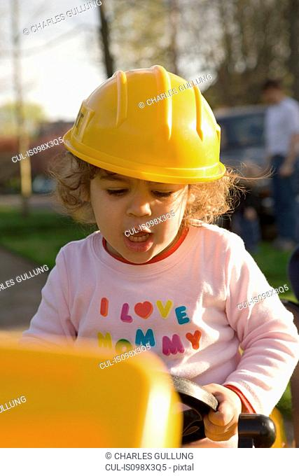 Young girl dressed up in hard hat