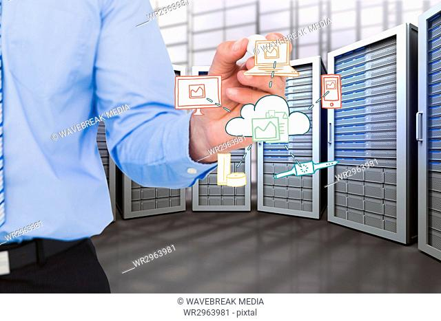 Business man holding drawings in server room