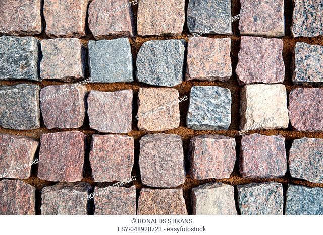 natural granite stone cobblestone. top view