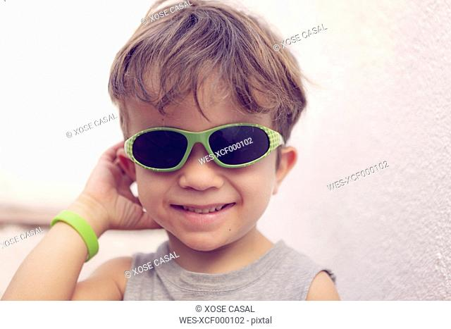 Portrait of smiling little boy wearing sunglasses