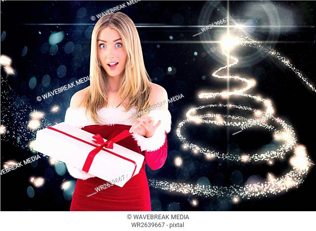 Surprised woman in santa costume opening a gift box