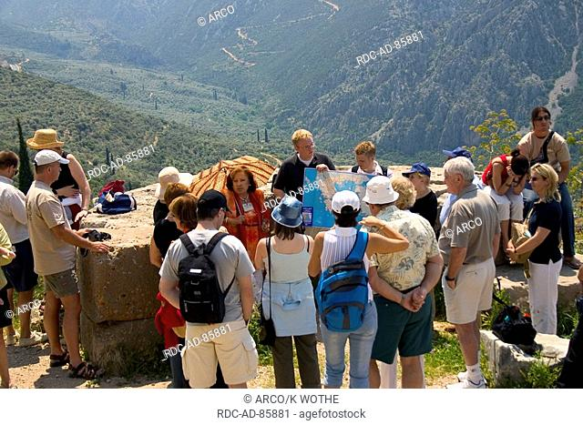 Tourist group with guide Delphi Greece