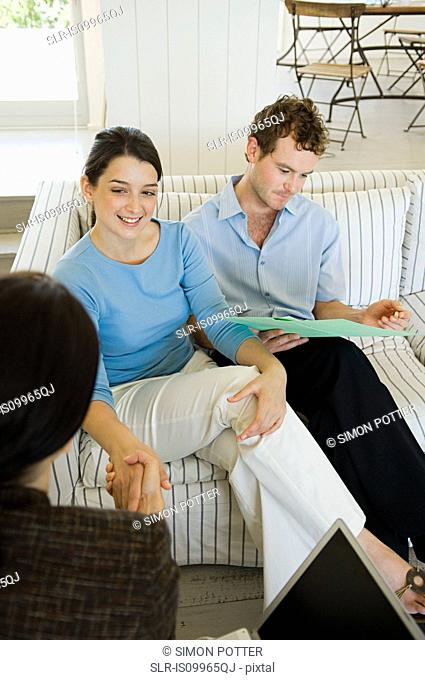 Couple meeting financial advisor at home
