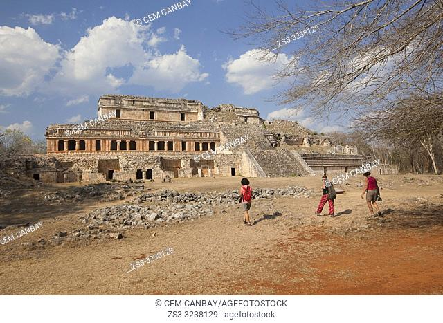 Tourists in front of the Great Palace- Palacio Norte in Maya Archaeological Site Sayil in the Puuc Route, Yucatan State, Mexico, Central America