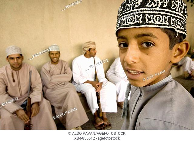 Men and boy at market, Nizwa, Oman