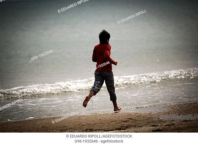 Boy running at the beach