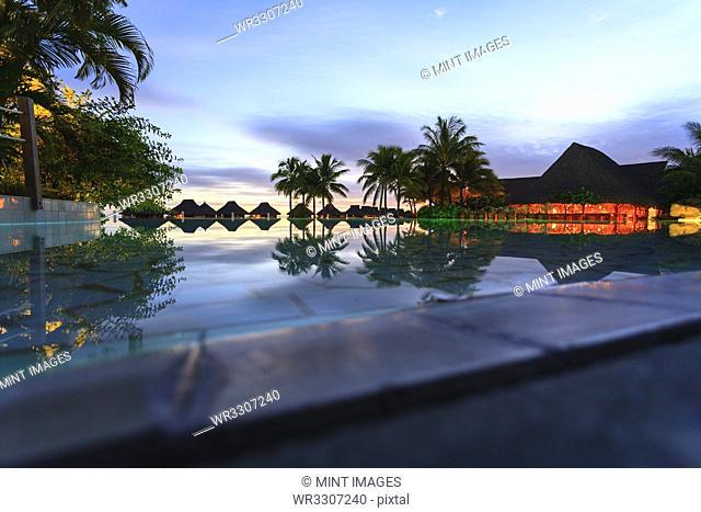 Palm trees and tropical resort, Bora Bora, French Polynesia