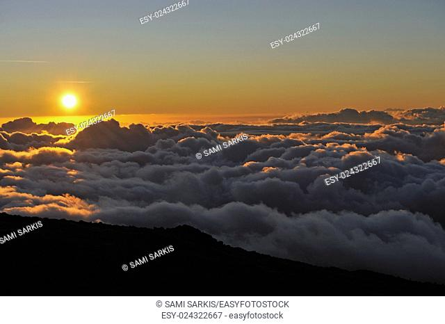 Above cloudscape at sunset, Maui Island, Hawaii Islands, Usa