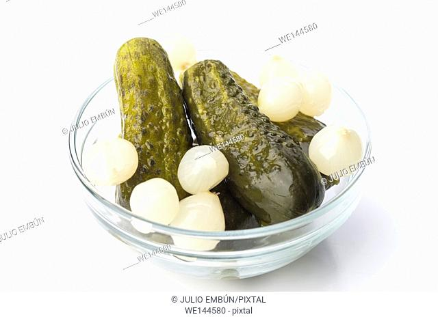 pickle bowl with some scallions on white background
