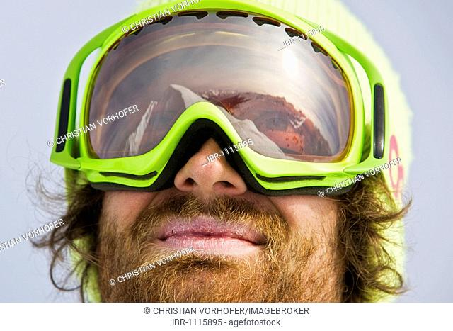 Mountain peak reflected in the goggles of a freestyle skier, Hochfuegen, North Tyrol, Austria, Europe