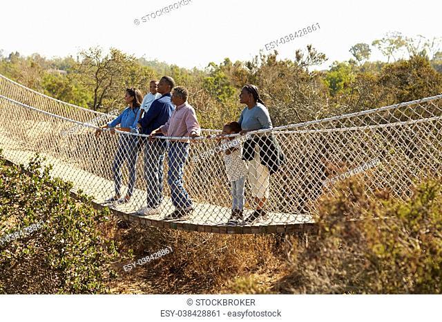 Multi Generation Family Crossing Rope Bridge Together