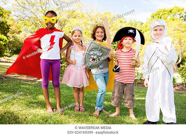 Children with fancy dress smiling and posing