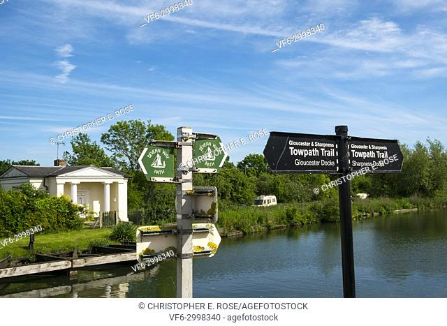 Sign posts for the Towpath Trail alongside the Severn Way Path at Splatt Bridge and bridge keepers cottage on the Gloucester & Sharpness Canal towpath at...