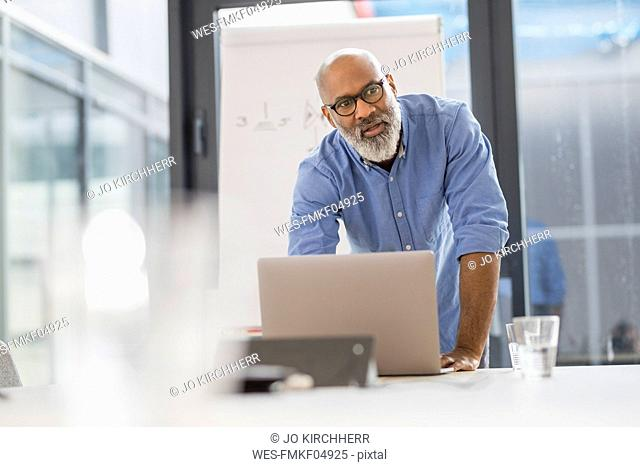Portrait of businessman in conference room leading a presentation