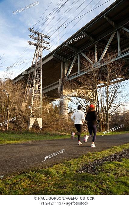 Two women running along the Burke-Gilman Trail - early morning  Seattle, Washington