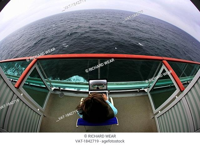 High angle view of person using laptop on boat