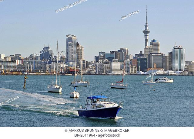 Water taxi in front of the Auckland skyline from Stanley Bay, Auckland, New Zealand