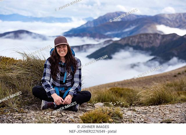 Smiling young woman with mountains in background
