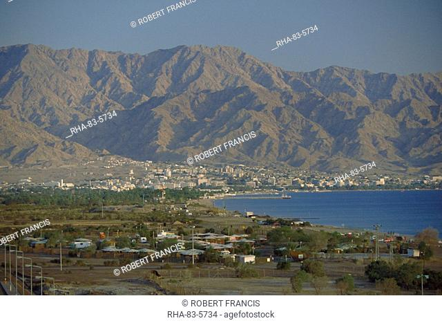 The Red Sea port of Aqaba and highlands beyond, seen from the Israeli resort of Eilat, Aqaba, Jordan, Middle East