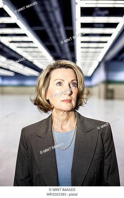 Portrait of a Caucasian businesswoman in a convention centre space
