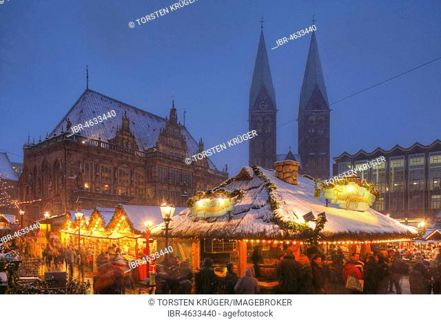 Old town hall with St. Petri Cathedral and Christmas market on the market square at dusk, Bremen, Germany