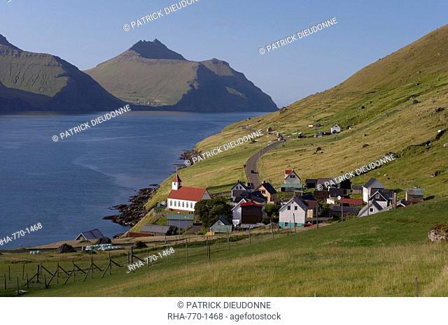 Village of Kunoy, located on the west coast of the island Kunoy, impressively surrounded by high mountains, Kunoy Island, Nordoyar, Faroe Islands Faroes