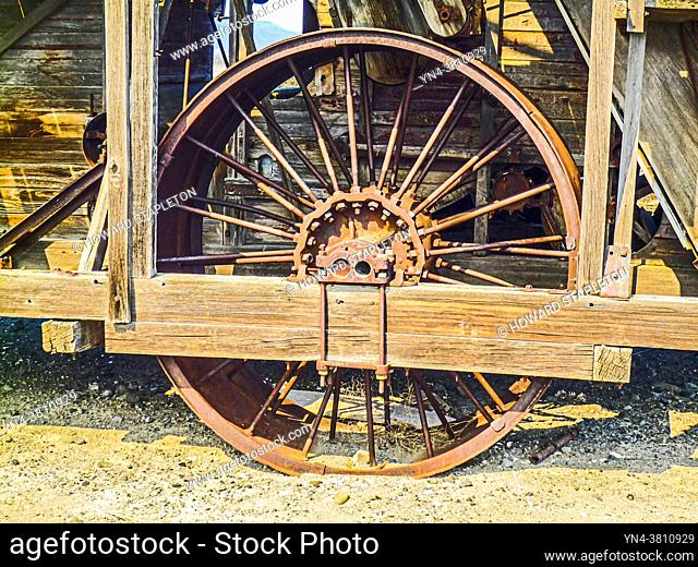 Wheel on a Harris Harvester built in 1920. This Harris 18' Giant Harvester was built in Stockton, California and seen here along a rural road near Tulelake